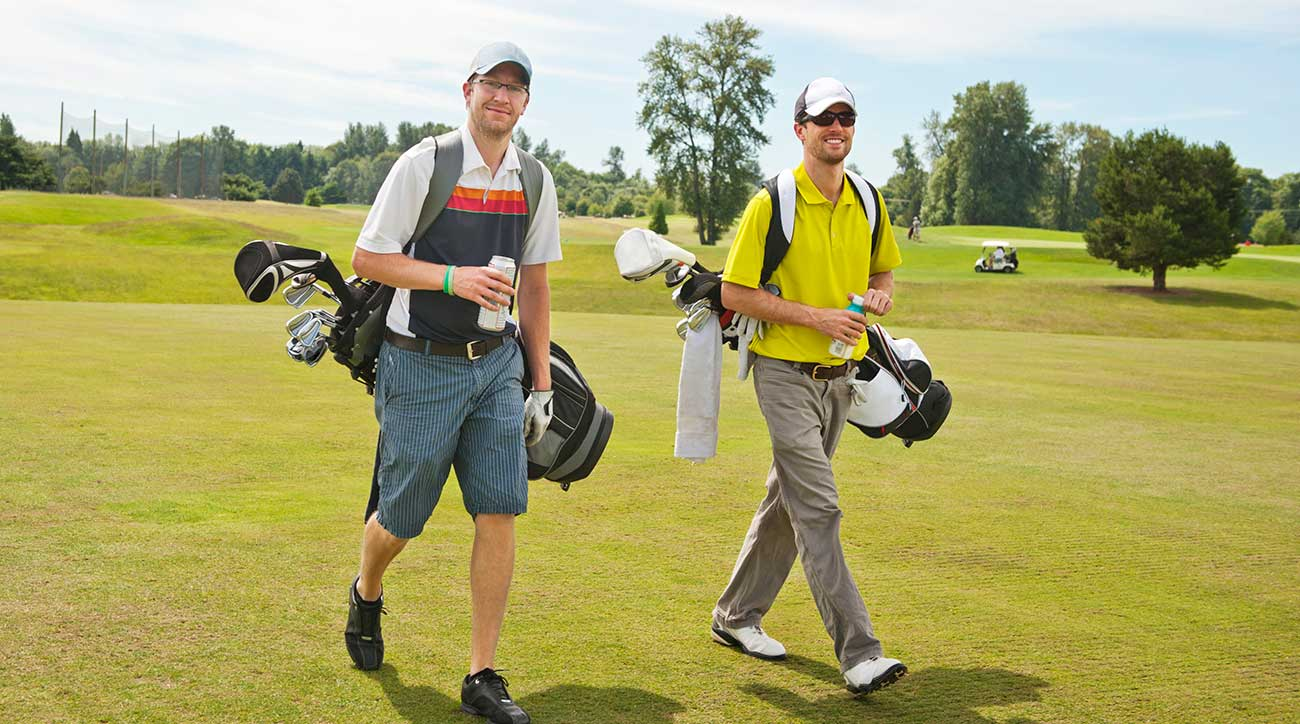 golfers-walking-on-green